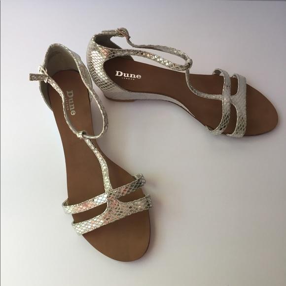3e549b5c1b Dune London Gain Silver Leather Wedge Sandals. M_5b46d3677386bc4ba0e4d9e8.  M_5b46d3692beb798fe902630d. M_5b46d36ade6f627e7140e210